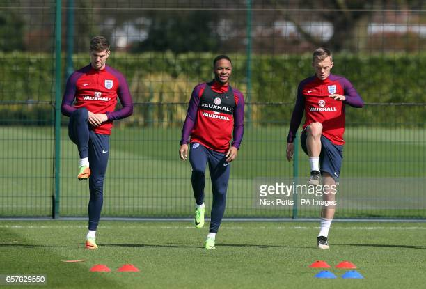 England's John Stones Raheem Sterling and James WardProwse during the training session at Enfield Training Ground London