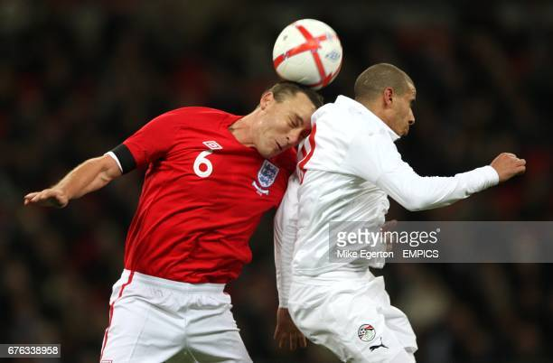 England's John Terry and Egypt's Mohamed Zidan battle for the ball