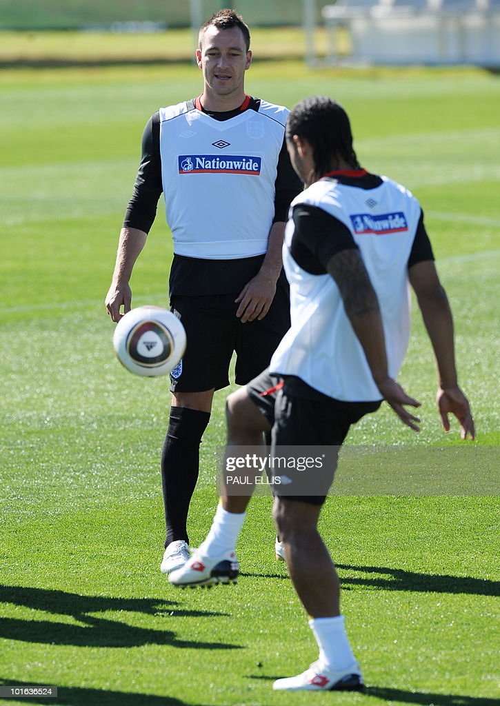 England's John Terry (L) and Glen Johnson take part in a training session at the Royal Bafokeng Sports Campus near Rustenburg on June 5, 2010.