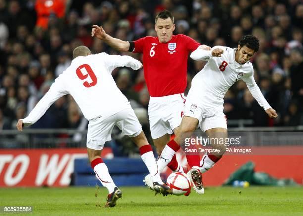 England's John Terry battles Egypt's Mohamed Zidan and Hosni Abd Rabou for the ball