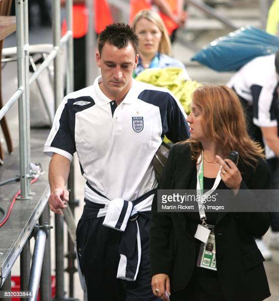 England's John Terry leaves the stadium after the match