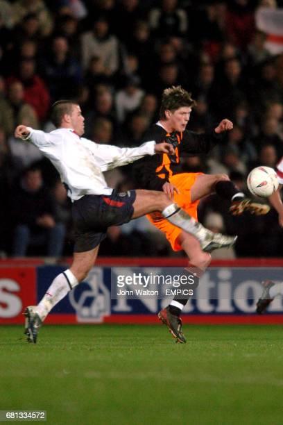 England's John Welsh and Holland's KlassJan Huntelaar battle for the ball