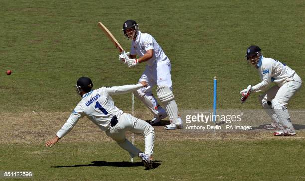 England's Jonathan Trott hits a shot past CA Invitational XI's Ryan Carters during an international match at the Sydney Cricket Ground Sydney