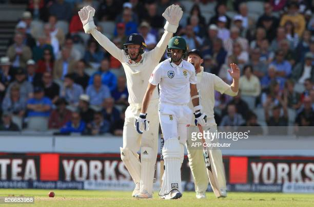 England's Jonny Bairstow and England's Ben Stokes celebrate the wicket of South Africa's Keshav Maharaj on the second day of the fourth Test match...