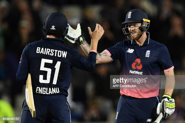 England's Jonny Bairstow and England's Ben Stokes celebrate victory after the first OneDay International cricket match between England and the West...