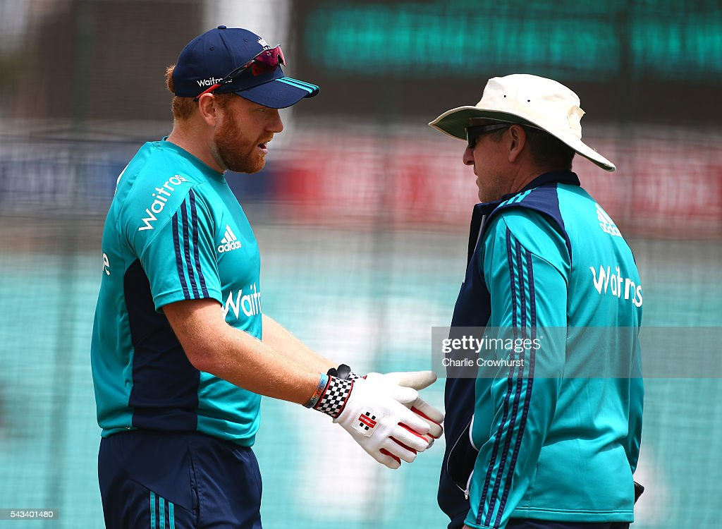 England's Jonny Bairstow chats with England cricket head coach <a gi-track='captionPersonalityLinkClicked' href=/galleries/search?phrase=Trevor+Bayliss+-+Cricket+Coach&family=editorial&specificpeople=14620221 ng-click='$event.stopPropagation()'>Trevor Bayliss</a> during a warm up exercise during an England & Sri Lanka Nets Session at The Kia Oval on June 28, 2016 in London, England.