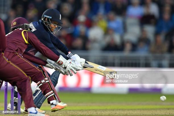 England's Jonny Bairstow plays a shot as West Indies' Shai Hope keeps wicket during the first OneDay International cricket match between England and...