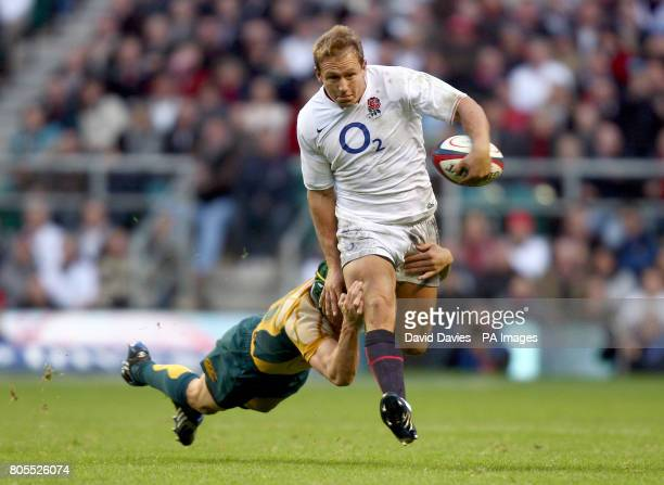 England's Jonny Wilkinson is tackled by Australia's Matt Giteau during the Investec Challenge Series match at Twickenham Stadium London