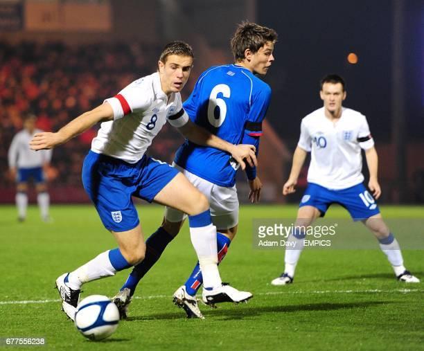 England's Jordan Henderson and Iceland's Eidur Aron Sigurbjornsson battle for the ball