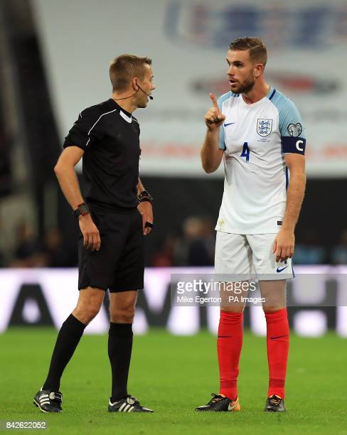 England's Jordan Henderson speaks with match referee Clement Turpin during the 2018 FIFA World Cup Qualifying Group F match at Wembley Stadium London