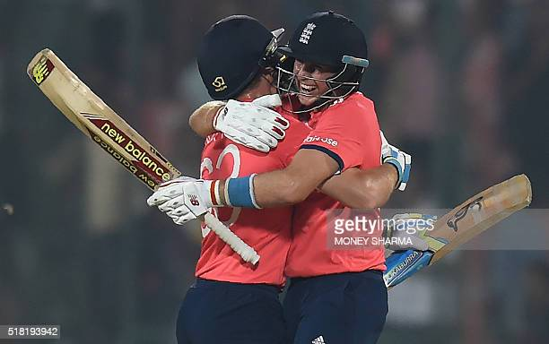 England's Jos Buttler and Joe Root celebrate after winning the World T20 cricket tournament semifinal match between England and New Zealand at the...