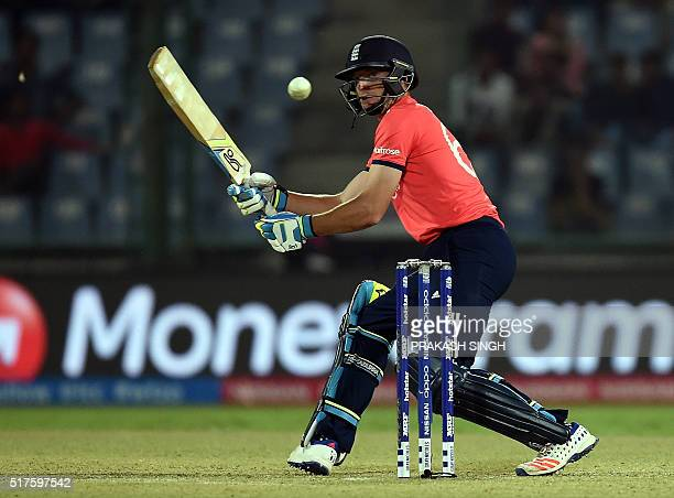 England's Jos Buttler plays a shot during the World T20 cricket tournament match between England and Sri Lanka at the Feroz Shah Kotla cricket ground...