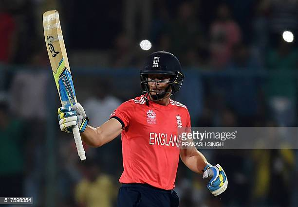 England's Jos Buttler raises his bat as he celebrates after scoring a halfcentury during the World T20 cricket tournament match between England and...