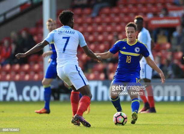 England's Joshua Onomah and Bosnia and Herzegovina's Amir Hadziahmetovic battle for the ball