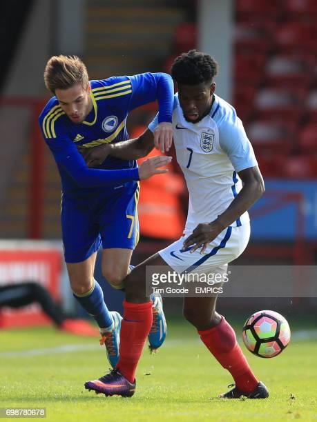 England's Joshua Onomah and Bosnia and Herzegovina's Kerim Memija battle for the ball