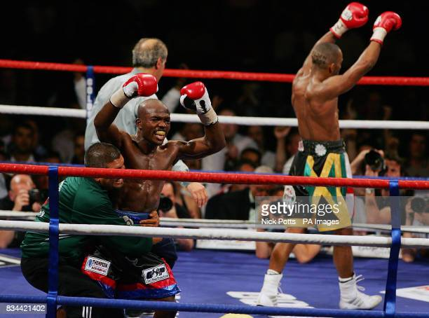 England's Junior Witter and USA's Timothy Bradley both celebrates at the end of the 12th round during the WBC LightWelterweight Title bout at...