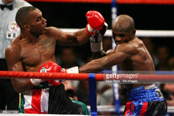 England's Junior Witter and USA's Timothy Bradley exchange punches during the WBC LightWelterweight Title bout at Nottingham Arena