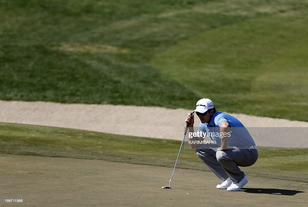 England's Justin Rose measures his shot during the third round of the Abu Dhabi Golf Championship at the Abu Dhabi Golf Club in the Emirati capital on January 19, 2013.