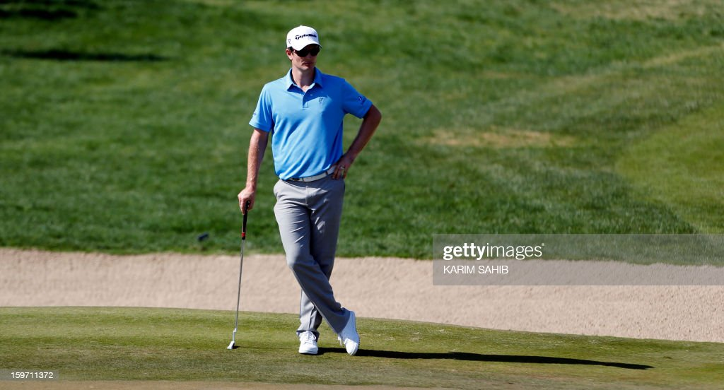 England's Justin Rose measures his shot during the third round of the Abu Dhabi Golf Championship at the Abu Dhabi Golf Club in the Emirati capital on January 19, 2013. AFP PHOTO/KARIM SAHIB