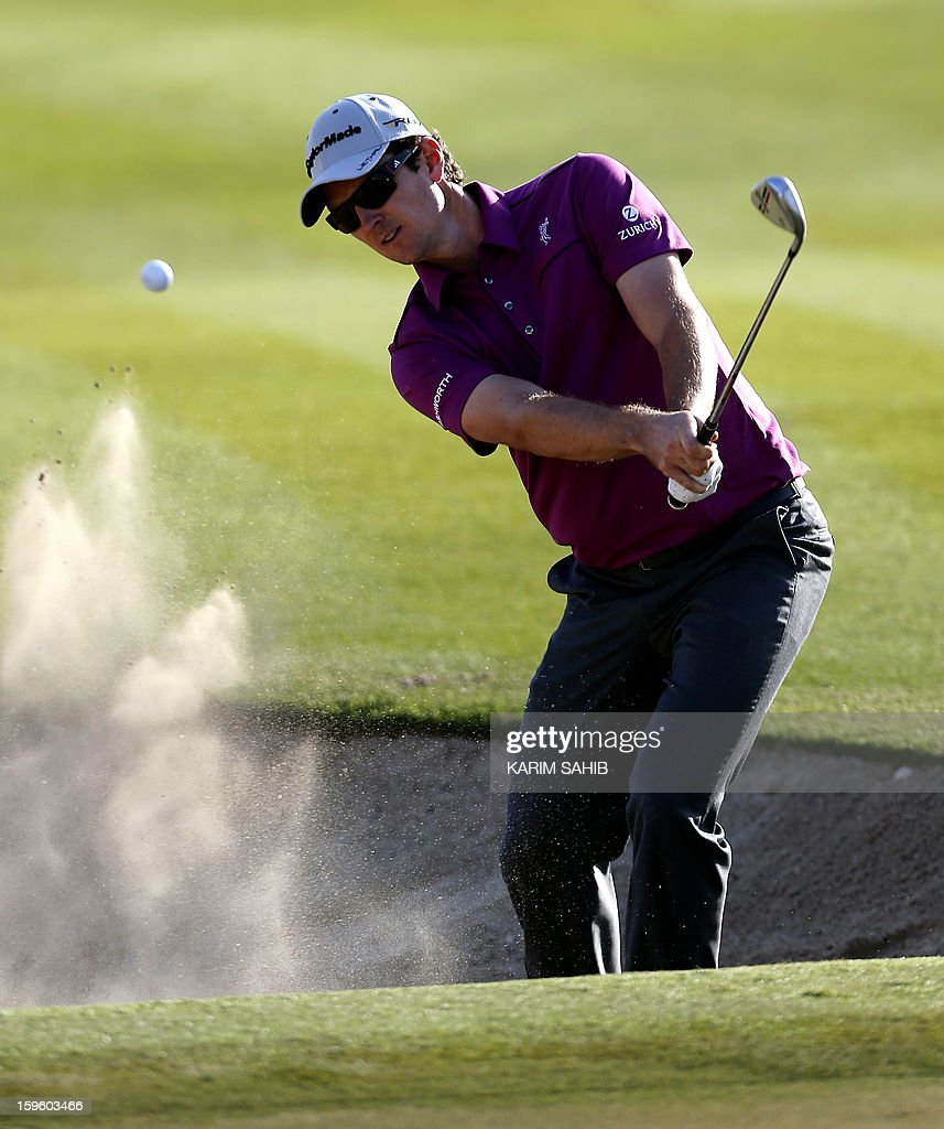 England's Justin Rose plays a shot during the first round of the Abu Dhabi Golf Championship at the Abu Dhabi Golf Club in the Emirati capital on January 17, 2013.