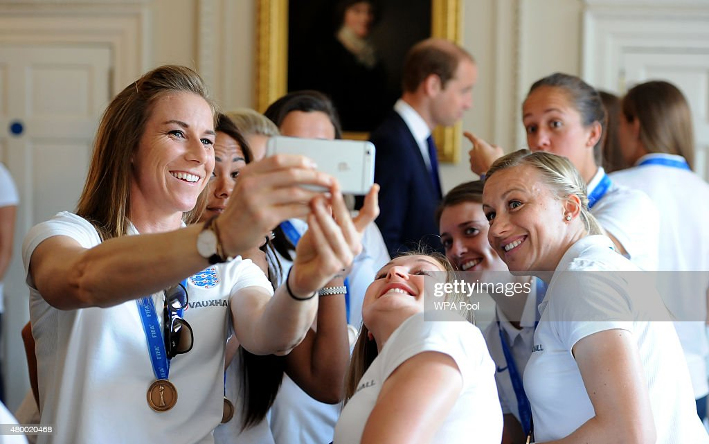England's Karen Bardsley (left) takes a selfie with her team mates in front of Prince William, Duke of Cambridge as he meets members of the England Women's Football team during a breakfast reception at Kensington Palace, on July 9, 2015 in London, England.