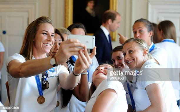 England's Karen Bardsley takes a selfie with her team mates in front of Prince William Duke of Cambridge as he meets members of the England Women's...