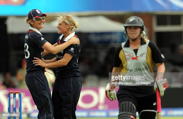 England's Katherine Brunt celebrates with captain Charlotte Edwards after taking the wicket of New Zealand's Lucy Doolan during the Final of the...