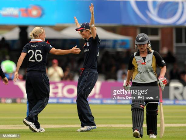England's Katherine Brunt celebrates with captain Charlotte Edwards after taking the wicket of Lucy Doolan during the Final of the Womens ICC World...