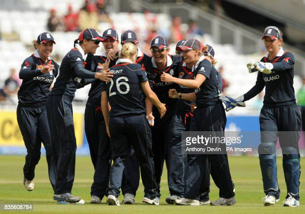 England's Katherine Brunt is congratulated after bowling out New Zealand's Aimee Watkins during the Final of the Womens ICC World Twenty20 at Lords...