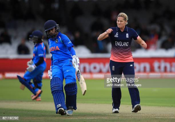 England's Katherine Brunt looks frustrated as India's Mithali Raj makes a run during the ICC Women's World Cup Final at Lord's London