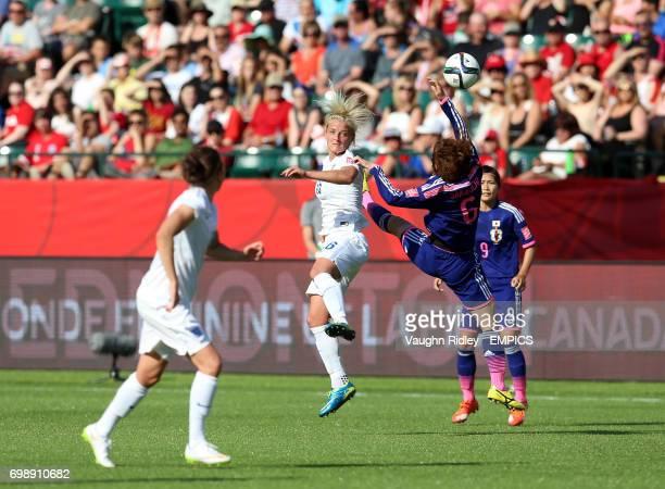 England's Katie Chapman and Japan's Mizuho Sakaguchi battle for a header during the FIFA Women's World Cup Canada 2015 Semi Final match between Japan...