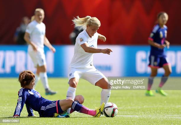 England's Katie Chapman gets past Japan's Mizuho Sakaguchi during the FIFA Women's World Cup Canada 2015 Semi Final match between Japan and England...