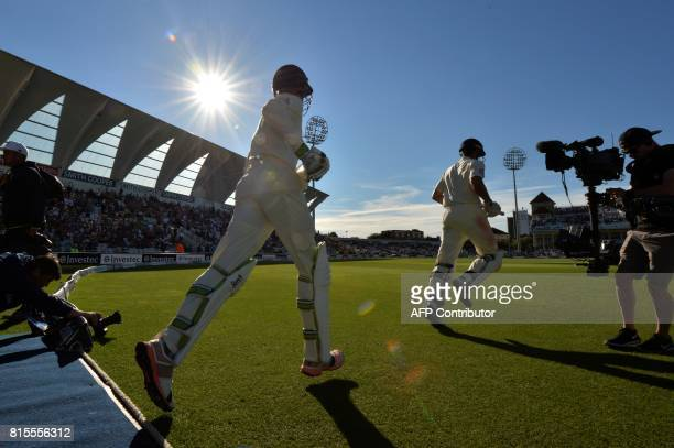 England's Keaton Jennings and Alastair Cook head onto the field to open the batting for England's second innings late on the third day of the second...