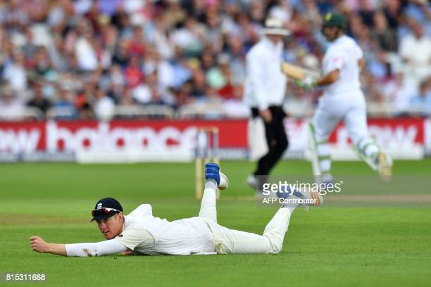 England's Keaton Jennings looks on after misfielding a shot from South Africa's Hashim Amla on the third day of the second Test match between England...