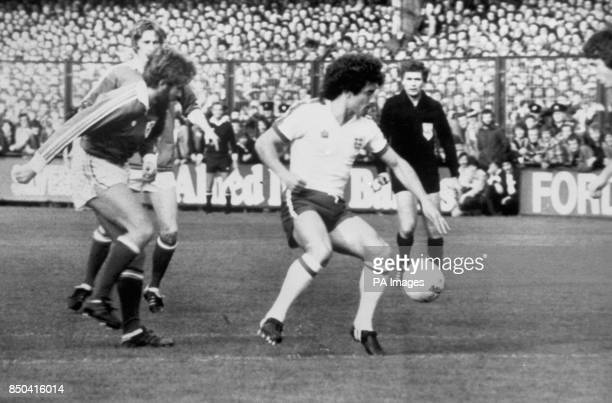 England's Kevin Keegan breaks past Tony Grealish and Gerry Daly of the Republic of Ireland during the European Championship match in Dublin The match...