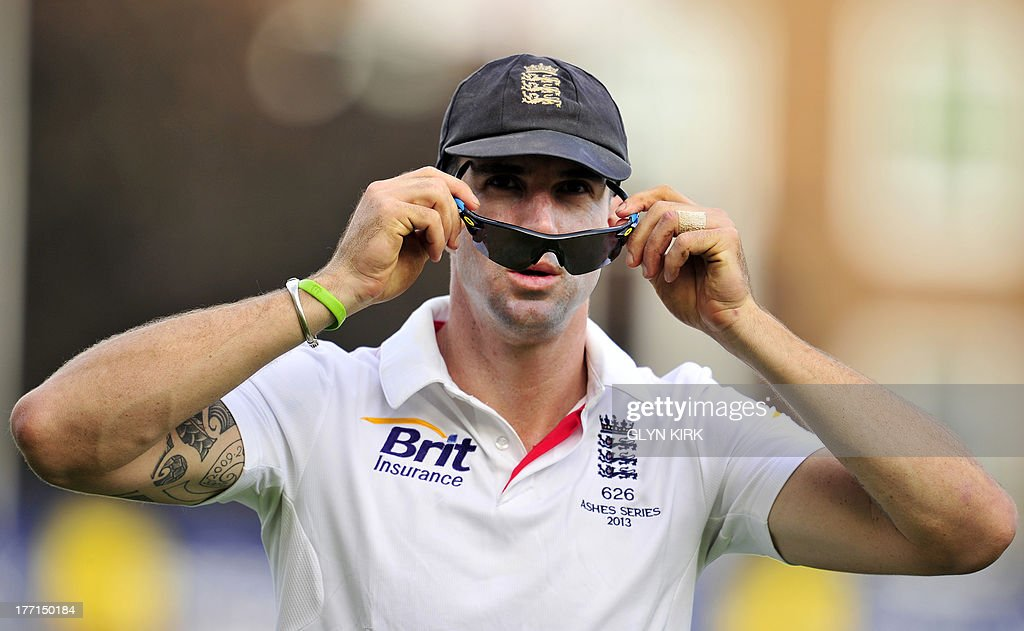 England's Kevin Pietersen adjusts his sunglasses during play on the first day of the fifth Ashes cricket test match between England and Australia at The Oval cricket ground in London on August 21, ...