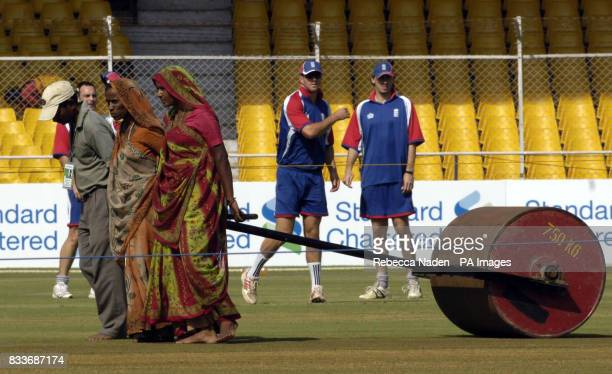 England's Kevin Pietersen and Rikki Clarke watch as a roller is pulled over the pitch during a practice session at the Sardar Patel Stadium Ahmedabad...