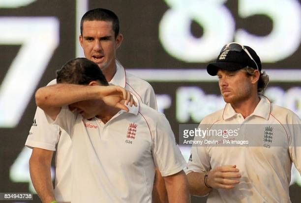 England's Kevin Pietersen Andrew Strauss and Ian Bell leave the field during the fifth day of the First Test Match at the M A Chidambaram Stadium in...