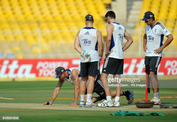England's Kevin Pietersen inspects the pitch as Matt Prior James Anderson and Alastair Cook lookon following a nets practice session at the Sardar...