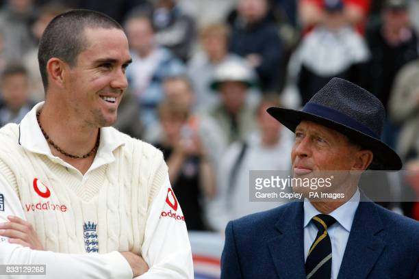 England's Kevin Pietersen laughs with former player Geoffrey Boycott following the fifth day of the Fourth npower Test at the County Ground...