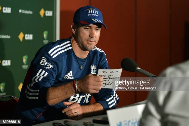 England's Kevin Pietersen receives a message from Wally Lewis as he speaks during a press conference at The Gabba Brisbane Australia