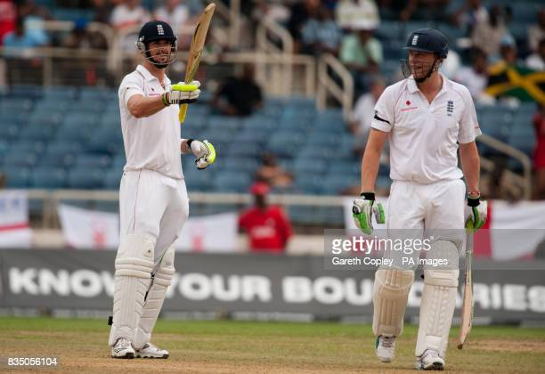 England's Kevin Pietersen salutes the crowd after reaching 50 as Andrew Flintoff watches on during the First Test at Sabina Park Kingston Jamaica