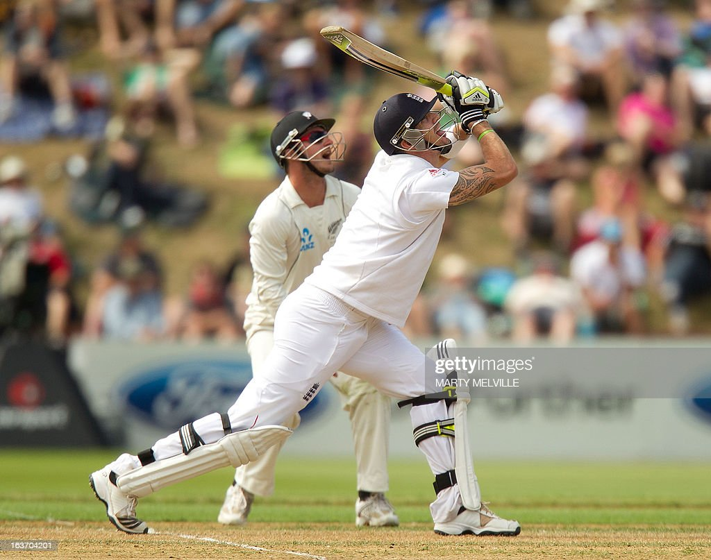 England's Kevin Pietersen skys the ball into the air and is then caught out by New Zealand's Peter Fulton during day two of the 2nd international cricket Test match between New Zealand and England played at the Basin Reserve in Wellington on March 15, 2013. AFP PHOTO / Marty MELVILLE