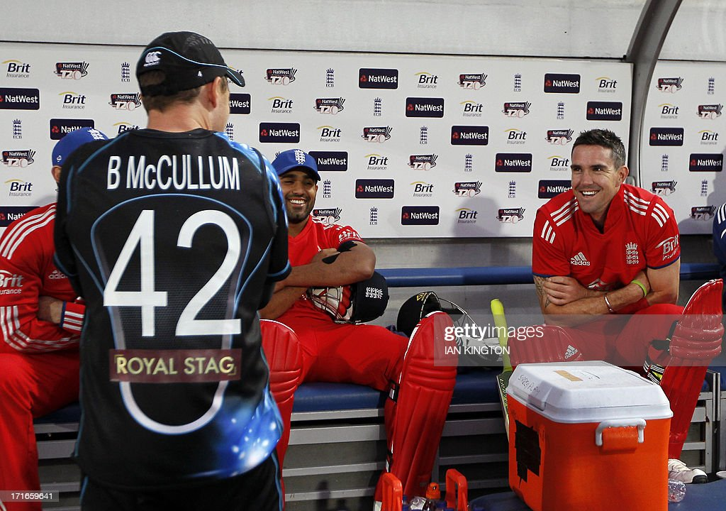 England's Kevin Pietersen (R) talks with New Zealand's Captain Brendon McCullum (L) as rain delays the match during the second T20 International cricket match between England and New Zealand at The Oval cricket ground in London on June 27, 2013. Pietersen's return to England duty saw him fail to take any part in a washed-out Twenty20 match that gave New Zealand a 1-0 series win. ECB