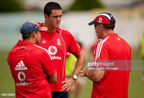 England's Kevin Pietersen talks with team security expert Reg Dickason and coach Andy Flower during a nets session at St Marys Sports Ground Port of...