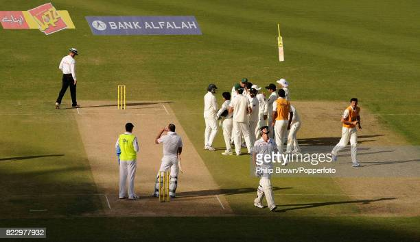 England's Kevin Pietersen throws his bat in the air while leaving the field after being dismissed for 32 runs in the 3rd Test match between Pakistan...