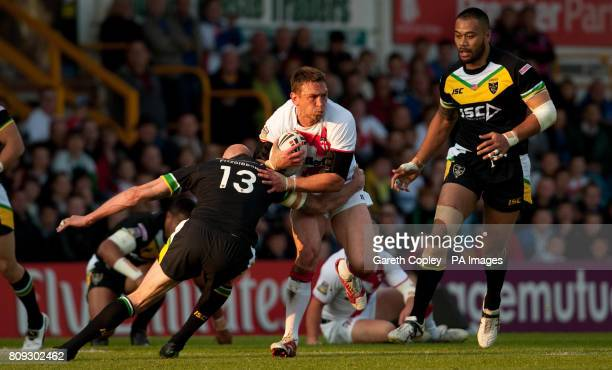 England's Kevin Sinfield is tackled by Exiles's Craig Fitzgibbon during the Car Plan International Origin match at Headingley Carnegie Stadium Leeds
