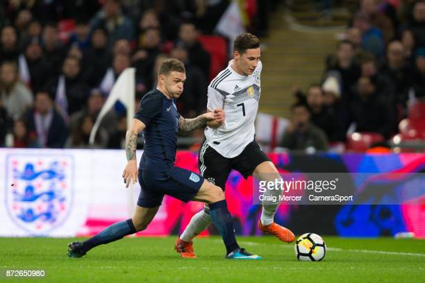England's Kieran Trippier vies for possession with Germanys Julian Draxler during the International Football Friendly match between England and...