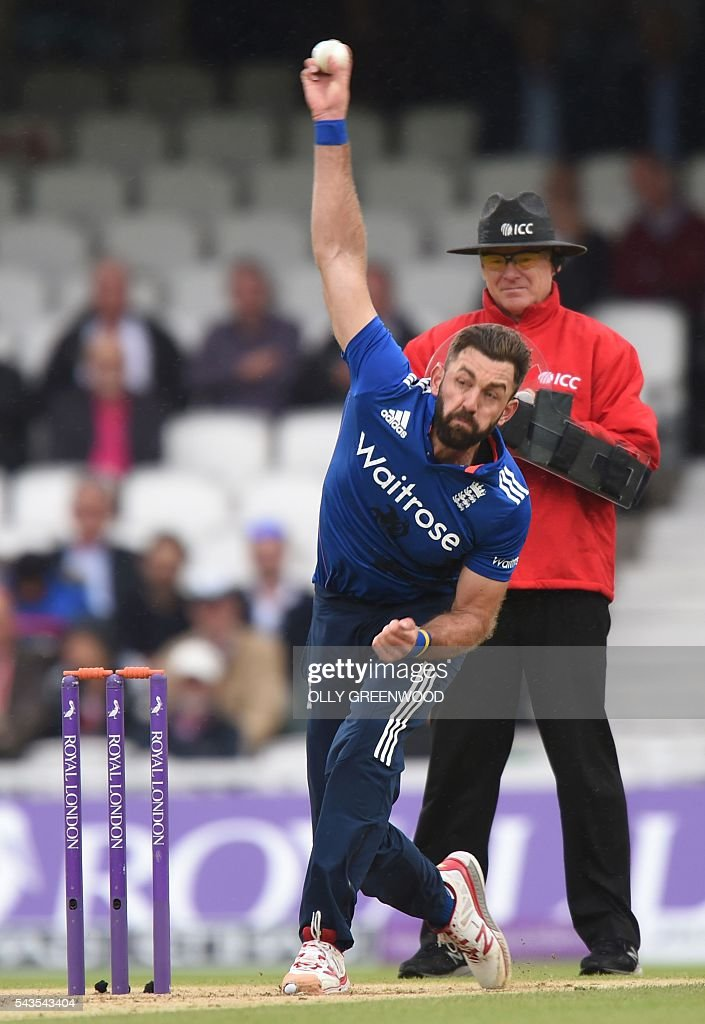 England's Laim Plunkett bowls during play in the fourth One Day International (ODI) cricket match between England and Sri Lanka at The Oval cricket ground in London on June 29, 2016. England captain Eoin Morgan elected to field after winning the toss in the fourth one-day international against Sri Lanka at The Oval on Wednesday. With light rain around and dark grey skies, Morgan clearly felt his bowlers could utilise the favourable bowling conditions with further down pours forecast during the afternoon and evening. ECB