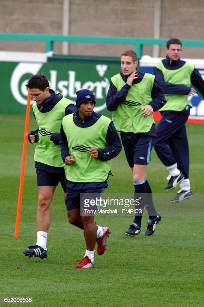 England's late replacement Michael Dawson follows Frank Lampard and Trevor Sinclair in the training warm up